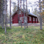 Cottage as seen from the woods