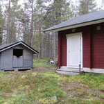 Firewood shed and the separate entrance to the storage building