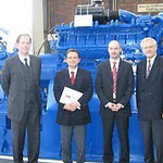 Guido Droste, Botschafter Vierita, Christian Wurst und Prof. Jüttner im Mannheimer Werk von Deutz Power Systems (von links)