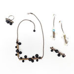 "Collection ""TUBES"" - 2014 Necklace, Earrings, Brooch and Ring in oxidized brass and glass beads"