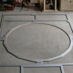 Circle within a rectangular aluminium stretcher