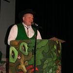 Der Oberzunftmeister Dieter Spitz begrüßt das Publikum