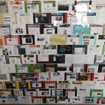 Wand mit Screenshots von Jimdo-Seiten