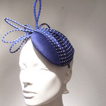Model Elin, navy blueFascinator with white polkadots made upon an Aliceband