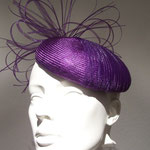 Model Yva,purple Parasisol straw cap with a wild trimming made from Crinolineband