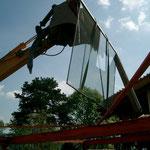 Teilrückbau Wohnhaus - Abbruch von Zwischentrakt in Mischbauweise, Holz, Glas, Stahl, Beton ect