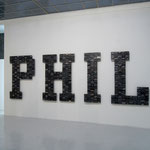 'untitled (PHIL Spector), painted wood, music cassettes, cable straps, 153 x 455 x 7 cm, 2008 - 2009
