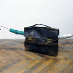 'untitled (sculptors secret weapon #4 aka the frogfish)', leather bag, brass, cherry-wood, spraypaint, 95 x 32 x 13 cm, 2016
