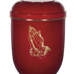 Rote Naturstoffurne mit betenden Händen als Motiv