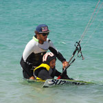 Children kitesurfing