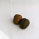 L'escargot: Praliné aux noisettes en chocolat lait ou fondant.