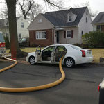 Firefighters were hampered by a car parked in front of the hydrant, they needed to adapt and improvise...