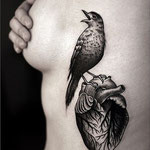 Tatouage oiseau et coeur