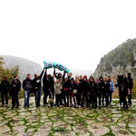 """Next to the deepest gorge of the World - participants """"throwing"""" the trash bag (full of things they would like to exclude from society) down in the gorge of Vikos"""