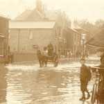 Flooding on the Warwick Road between the Green and Dudley Park Road, c. 1905. The Westley Brook flows under here, and has proved troublesome until sewer works at Station Road in the 1990s were undertaken. The cottages on the left are by the old New Inn.