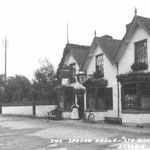 "The Spread Eagle Inn, c. 1905. This stood where the pedestrian lights near Victoria Road are now. The licensee, Matthew Bissell, liked to call it the ""Manor House"", which it was not. The Spread Eagle was demolished in 1928.The name has been resurrected."