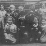 Dolphin Lane Infants. Jean Mercer is far right on the back row as we look