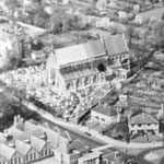 Part of an aerial photograph of Acocks Green, taken in 1950. The new roof is visible, and also the original vicarage, demolished in 1974. The land was sold to the city for housing, and a house on Dudley Park Road became the vicarage.