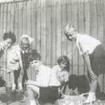 Miss King's class, 1939: learning about frogs (thanks to Brenda Nicolle, who is crouching by the fence). left to right are Bill Roberts, Jean Holt,  Gareth Edwards, Brenda Nicolle, and John ?