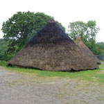Smoke escaping through the roof of the 'Earthwatch Roundhouse'.
