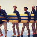 5 beach boys and 1 surfboard