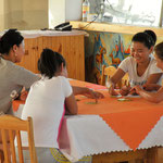 waitresses playing cards instead of working in a restaurant in the Gobi