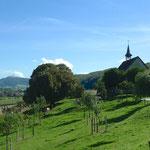 Blick auf Cornol und die Kapelle St. Gilles