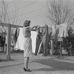 Proper attire for hanging clothes - Farm Security Adminstration