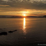 der Sonnenuntergang hinter dem Capo Caccia