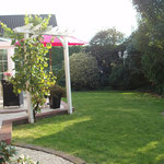 Wintergarten und Garten Ferienwohnung Gartenidylle Ostfriesland Leer