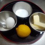 材料はタマゴ1個、レモン1個、グラニュー糖50g、バター50g、以上。