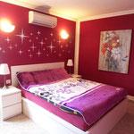 Schlafzimmer mit Doppelbett + Klimaanlage