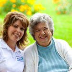 Visiting Angels caregiver enjoying some sunshine with her care recipient