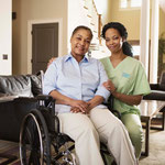 Visiting Angels caregiver with a client in a wheelchair in her home