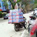 20 cartons of water on one scooter