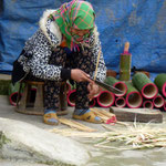 lady making incense sticks