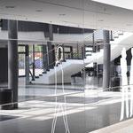 Halle Münsterland | Lack- und Folien-Dekor auf einer Glaswand
