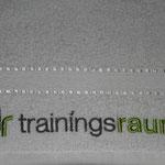Bild: Logo-Bestickung auf Handtüchern und Polos