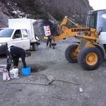 Heizwerk Zürs Schacht betonieren, mit Lader 509 und Betonmischtrommel