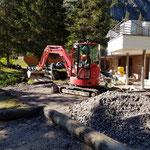 Neubau Waldbad: Planie ausbringen für Asphaltierarbeiten