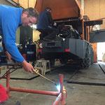 Reparaturarbeiten an Stapelgestell
