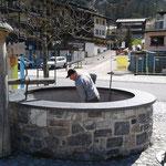 Dorfbrunnen säubern