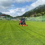 Rasenpflege Fußballplatz mit Holder C70 SC