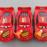 From left to right: Lightning McQueen w/cone (V1) - Lightning McQueen w/cone Puzzle box variant Unibody (V2) - Lightning McQueen w/cone (V3)