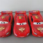 Lightning McQueen Racing Wheels V1 (L) vs V2 (M) and V3 (R)