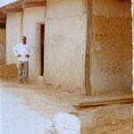 Mr. Seidu in front of the reconstructed school office (not in same building)