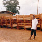 200 school desks constructed with project funds (at right Mr. Seidu)