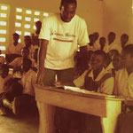 A school class, showing one on the new desks purchased with project funding