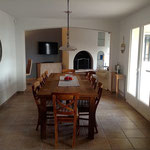looking from kitchen through dining room to living room, teak table 280 x 100 cm