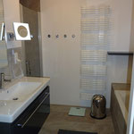 Bathroom with bathtub and shower in the ground floor